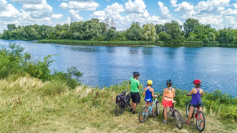 Family On Bikes Cycling Outdoors - How To Get Into Cycling
