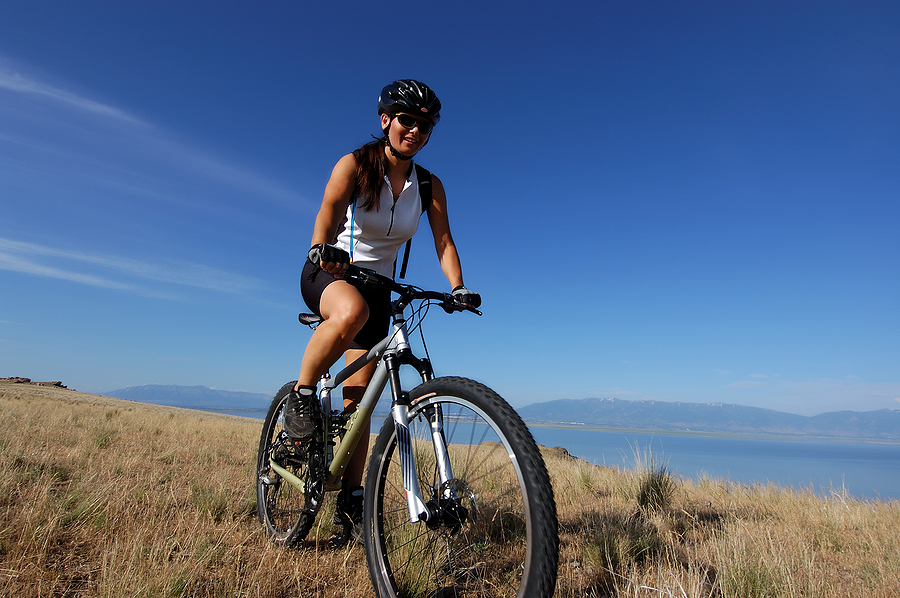Best Cycling Socks for Women - Woman Cycling in the mountains